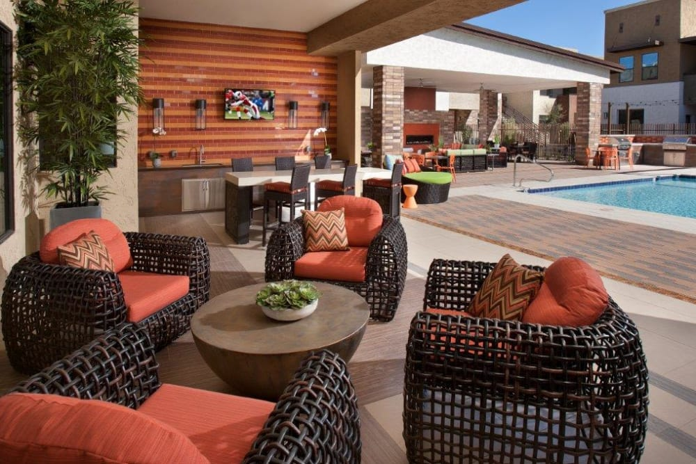 Comfortable seating for all at an outdoor lounge area near the pool at Vive in Chandler, Arizona