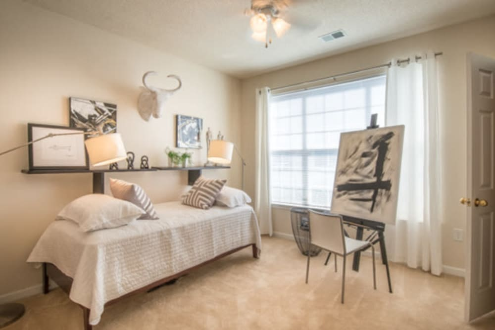 Guest room setup as an art studio in a model apartment at Walden at Chatham Center in Savannah, Georgia