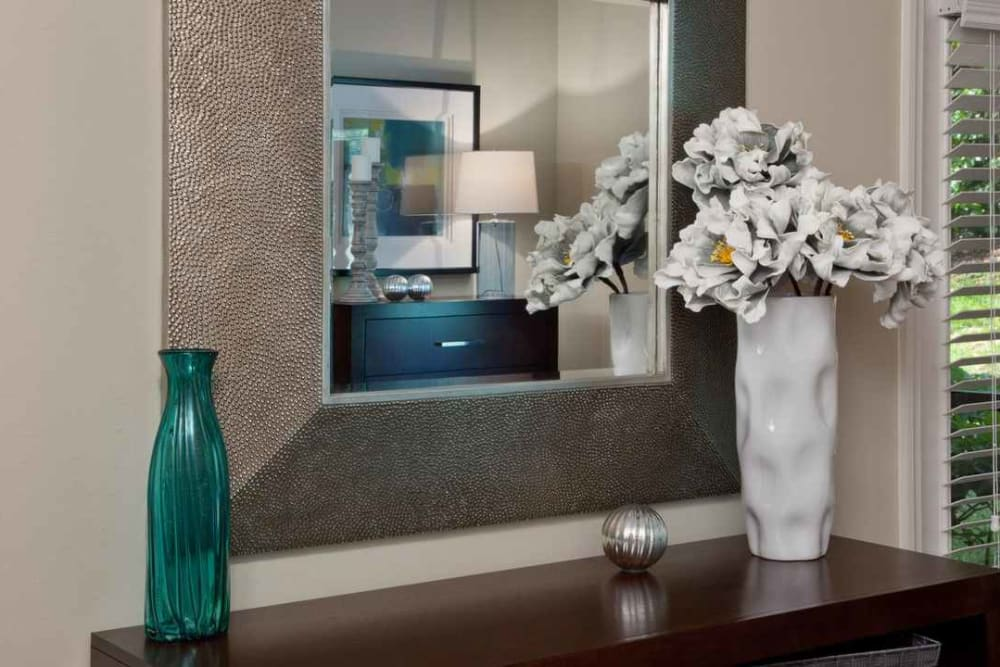 Decorative vases on an end table in a model apartment at Wimberly at Deerwood in Jacksonville, Florida