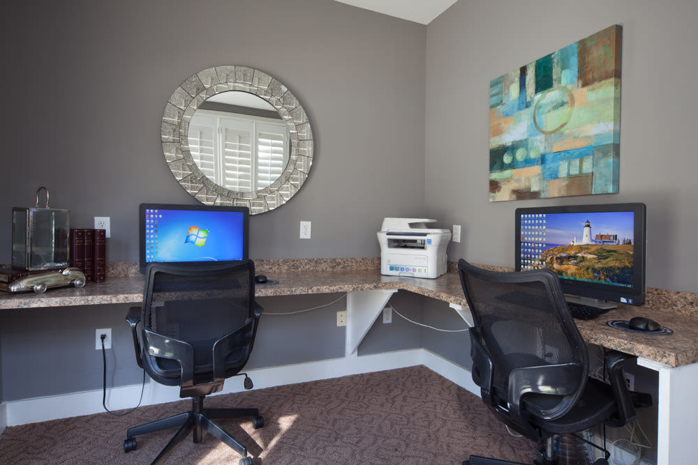 Computer workstations in the business center at Wimberly at Deerwood in Jacksonville, Florida