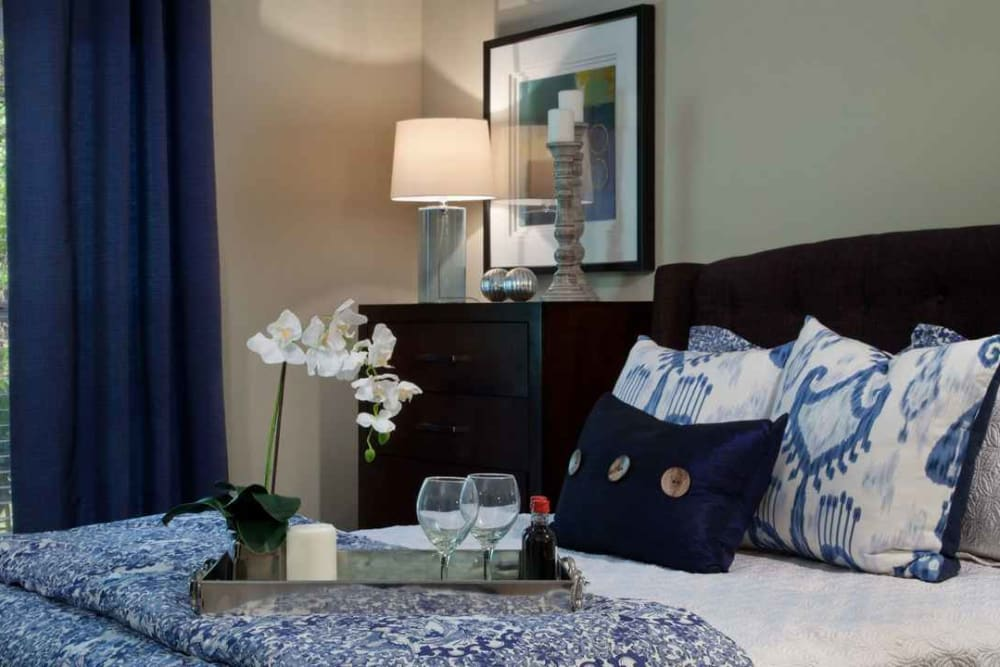 Well-decorated master bedroom in a model apartment at Wimberly at Deerwood in Jacksonville, Florida