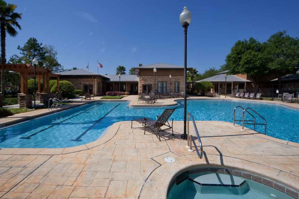 Beautifully designed swimming pool and spa area at Wimberly at Deerwood in Jacksonville, Florida