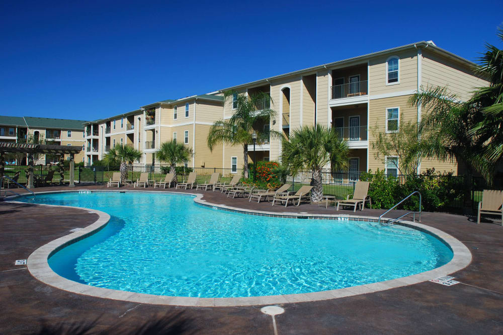 Resort-style swimming pool at Olympus Court Apartments in Bakersfield, California