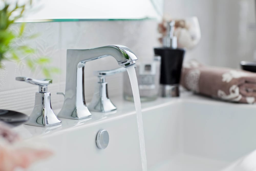Modern fixtures in a model apartment's bathroom at Olympus Court Apartments in Bakersfield, California