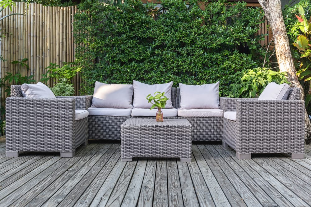 Well-furnished outdoor lounge area at Olympus Court Apartments in Bakersfield, California