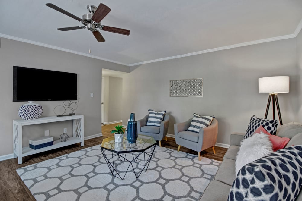 Spacious living room with a ceiling fan at Legacy at Tech Center in Newport News, Virginia