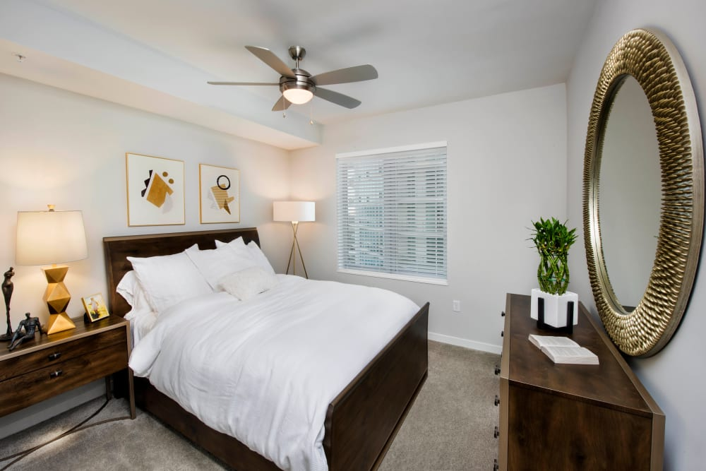 Ceiling fan and plush carpeting in a model apartment's bathroom at Olympus Harbour Island in Tampa, Florida