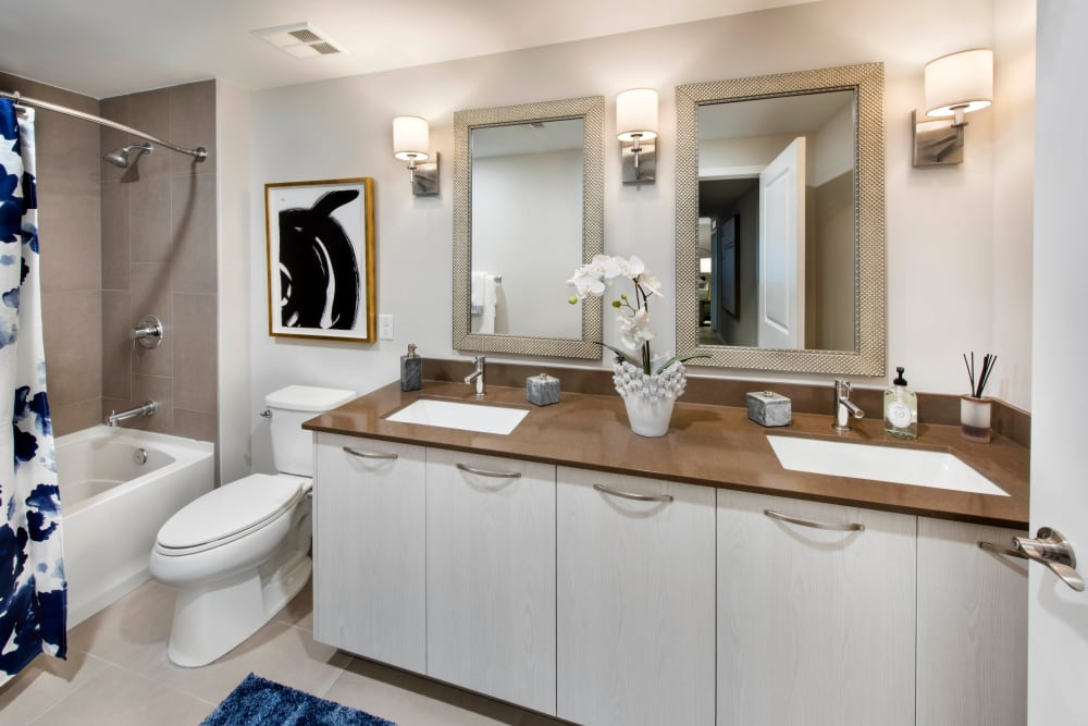 Dual sinks and individual vanity mirrors in a model home's master bathroom at Olympus Harbour Island in Tampa, Florida