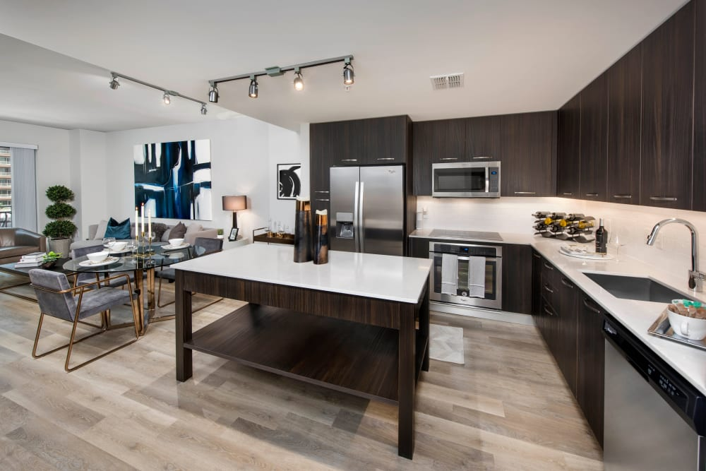 Espresso wood cabinetry in a model home's gourmet kitchen at Olympus Harbour Island in Tampa, Florida