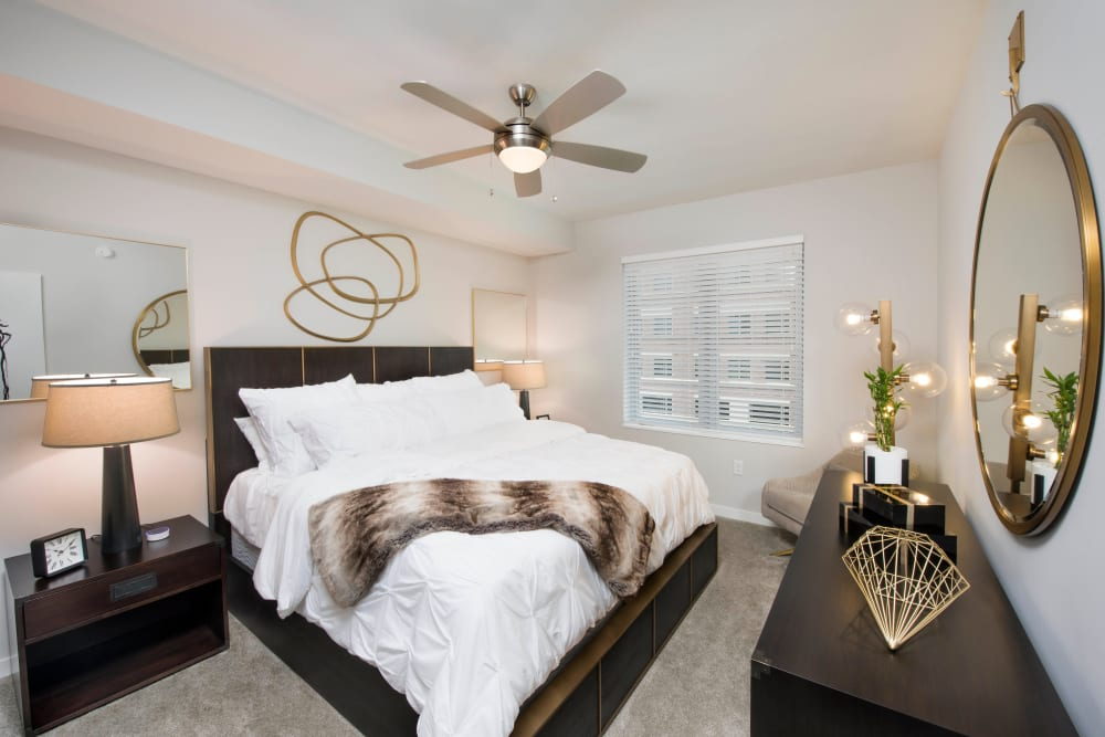 Ceiling fan and plush carpeting in a model home's master bedroom at Olympus Harbour Island in Tampa, Florida
