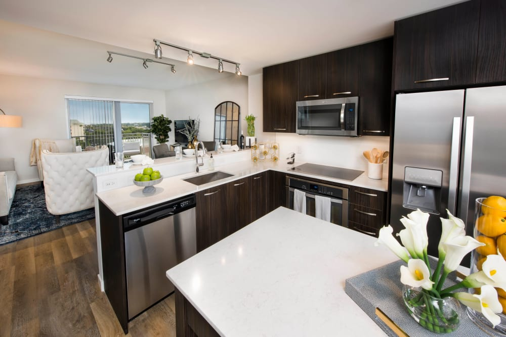 Gorgeous quartz countertops and an island in a model luxury home's gourmet kitchen at Olympus Harbour Island in Tampa, Florida