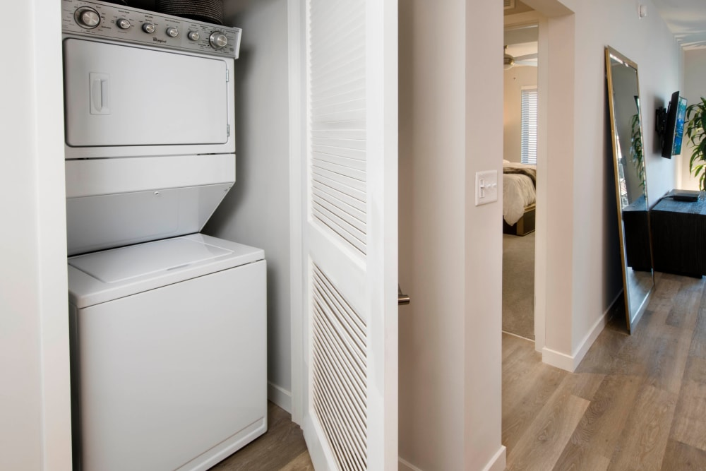 In-unit washer and dryer in a model apartment at Olympus Harbour Island in Tampa, Florida