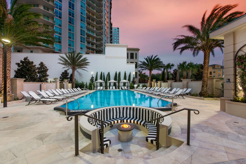 Luxurious fire pit area at dusk at Olympus Harbour Island in Tampa, Florida