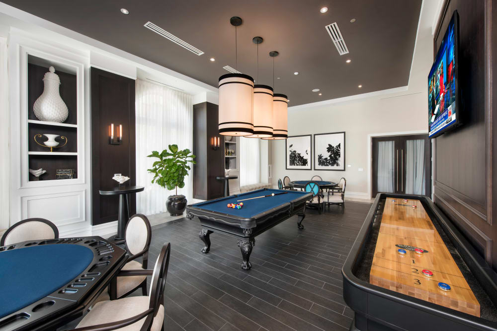 Game room with tabletop shuffleboard, billiards, and more in the clubhouse at Olympus Harbour Island in Tampa, Florida