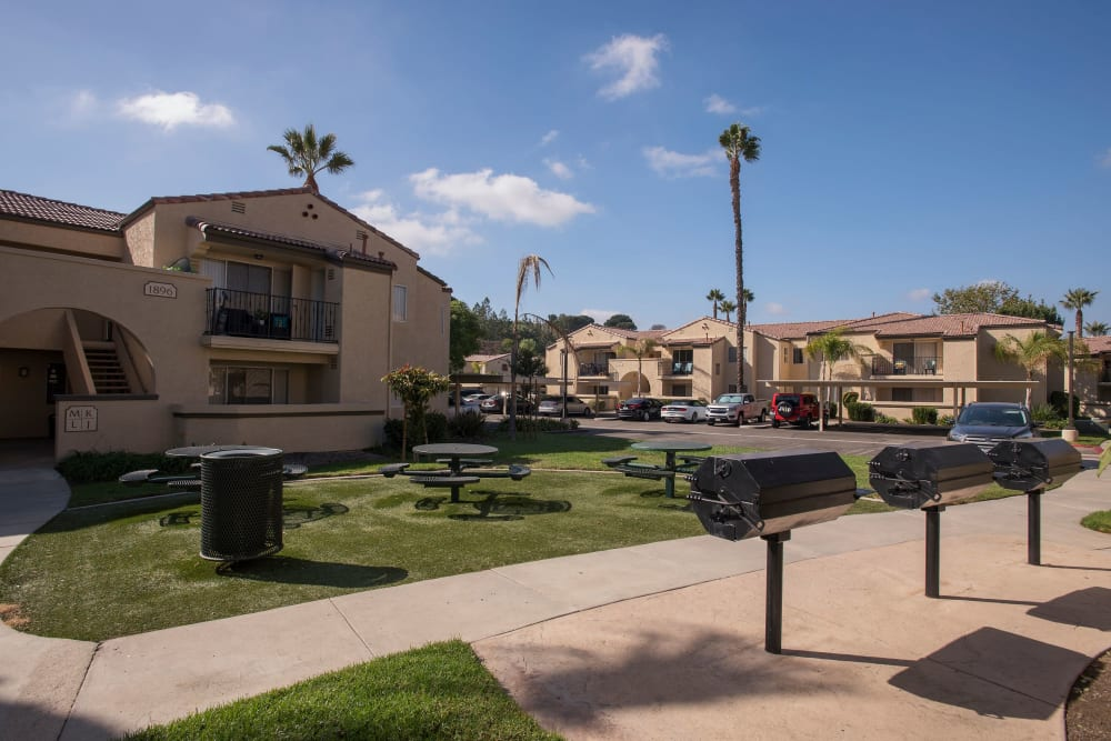 Picnic area with tables and barbecues at Shadow Ridge Apartment Homes in Simi Valley, California