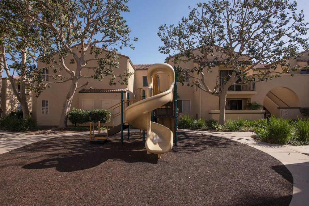 Children's playground with a slide at Shadow Ridge Apartment Homes in Simi Valley, California