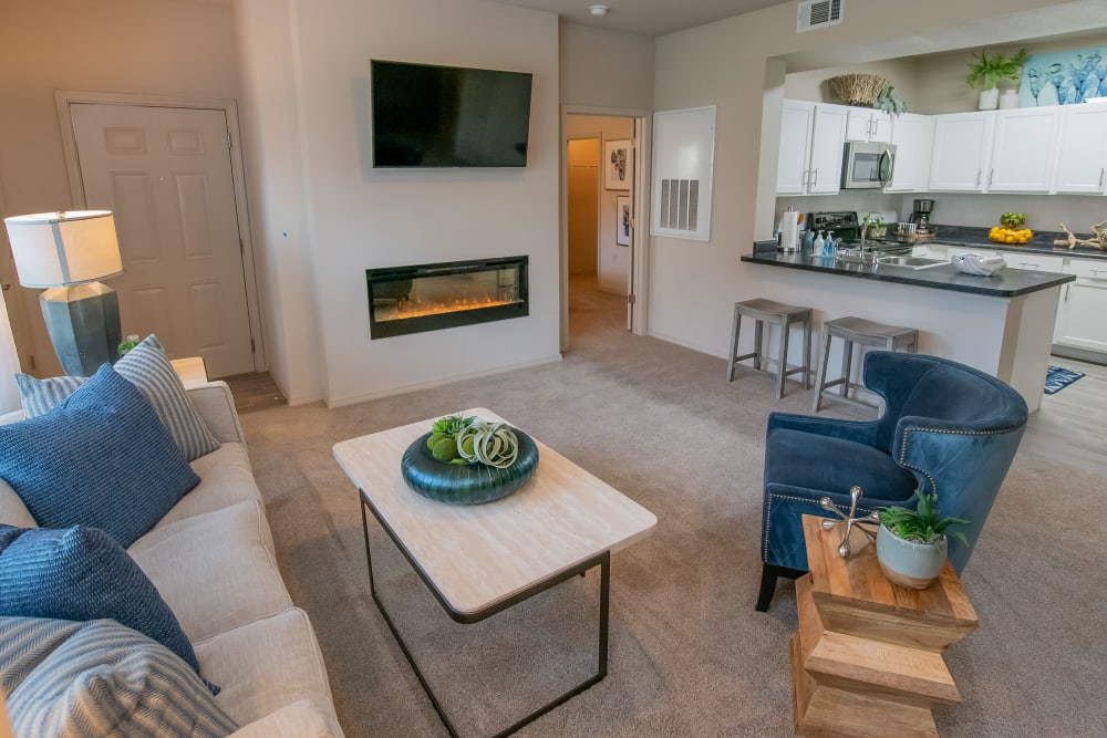 Stunning living room with plush carpet at Bend at New Road Apartments in Waco, Texas