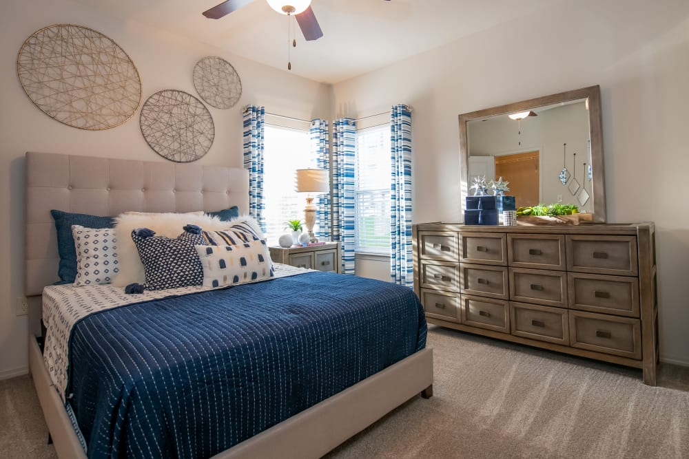 Master bedroom at Bend at New Road Apartments in Waco, Texas