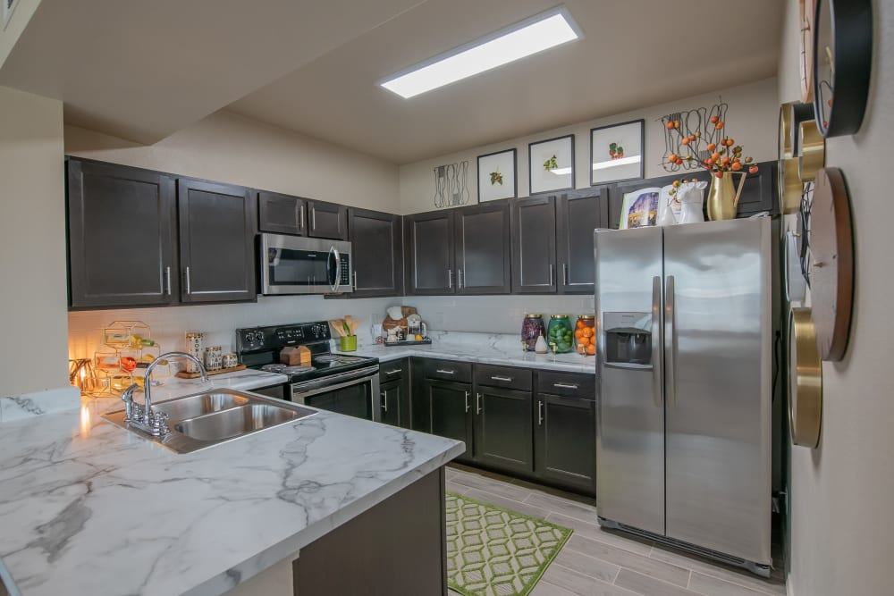 Fully equipped kitchen at Bend at New Road Apartments in Waco, Texas
