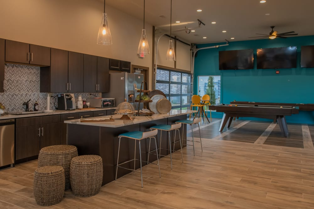 Community kitchen in Bend at New Road Apartments's clubhouse in Waco, Texas