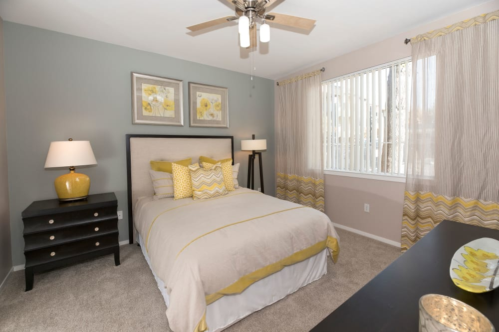 Large master bedroom with a large window at Cross Pointe Apartment Homes in Antioch, California