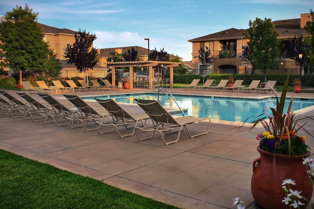 Large swimming pool with a sundeck at Cross Pointe Apartment Homes in Antioch, California