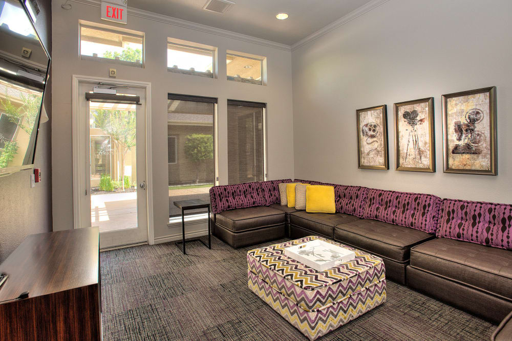 Screening room with a large couch at Cross Pointe Apartment Homes in Antioch, California