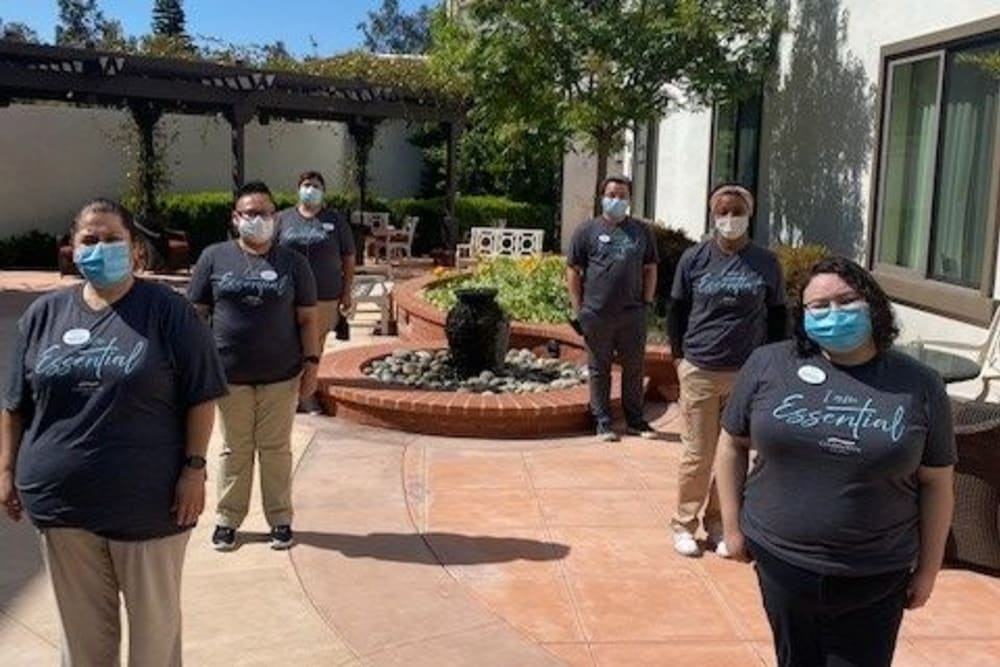 A group of staff members wearing protective masks