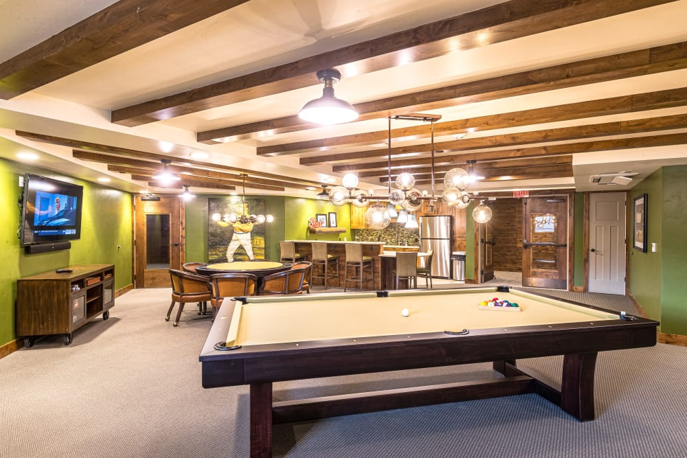 game room with pool table and poker table