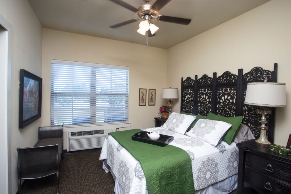 Side view of a bedroom in an apartment at The Claiborne at Thibodaux in Thibodaux, Louisiana