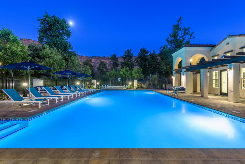 Underwater lights on in the pool at dusk at Mission Hills in Camarillo, California