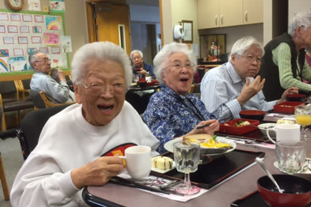 Residents enjoying a meal at Nikkei Manor in Seattle, Washington