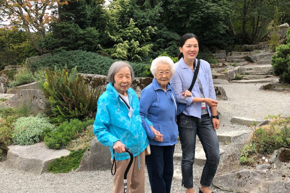 Residents enjoying a walk near Nikkei Manor in Seattle, Washington