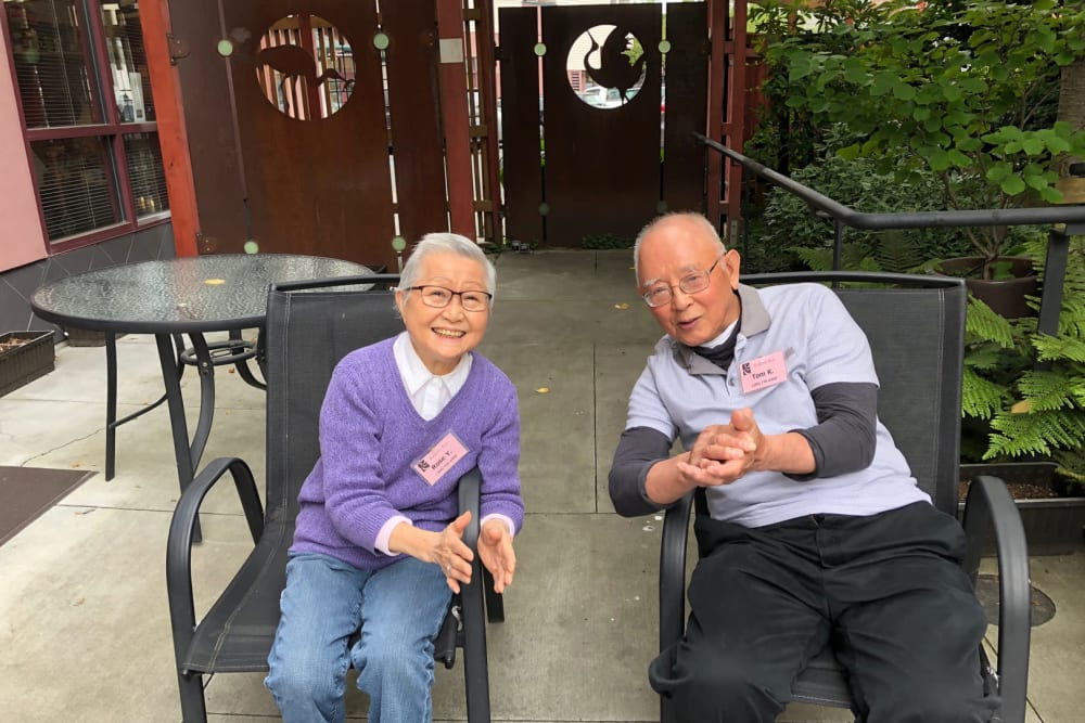 Two seniors hanging out outside of Nikkei Manor in Seattle, Washington