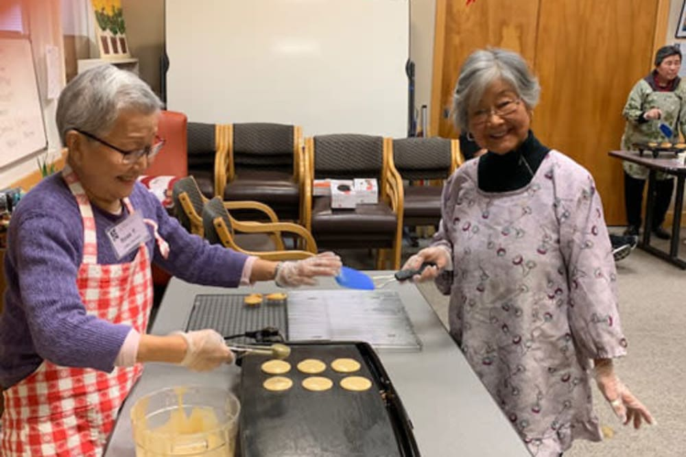 Two residents enjoying home baked cookies at Nikkei Manor in Seattle, Washington