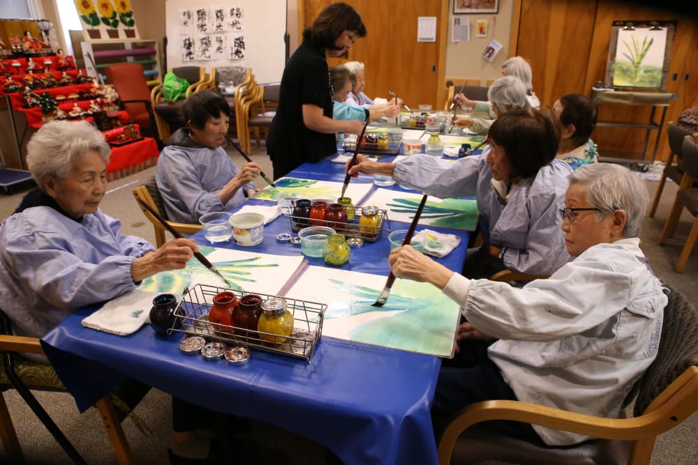 A group of residents painting at Nikkei Manor in Seattle, Washington