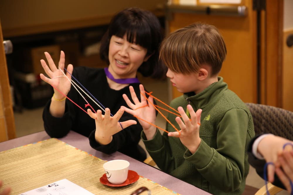A resident with her grandson at Nikkei Manor in Seattle, Washington
