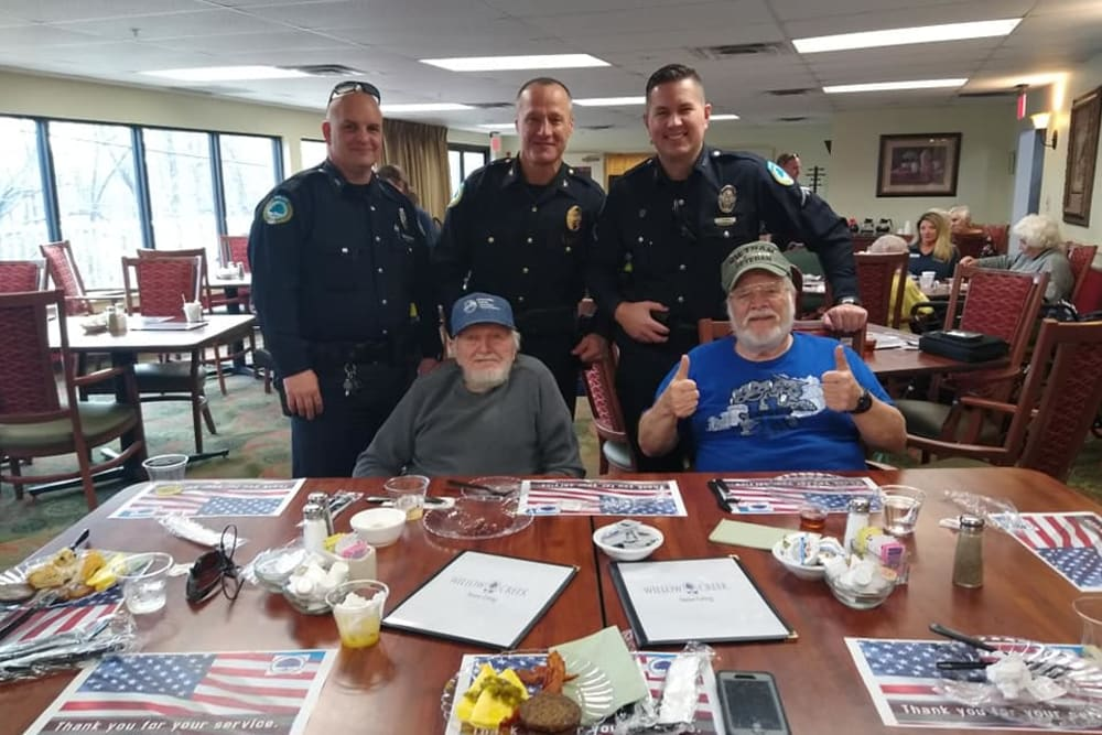 Police officers visit for an event at Willow Creek Senior Living in Elizabethtown, Kentucky.