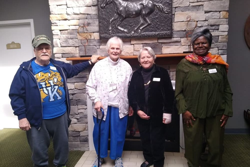 Residents pose in front of the fireplace at Willow Creek Senior Living in Elizabethtown, Kentucky.