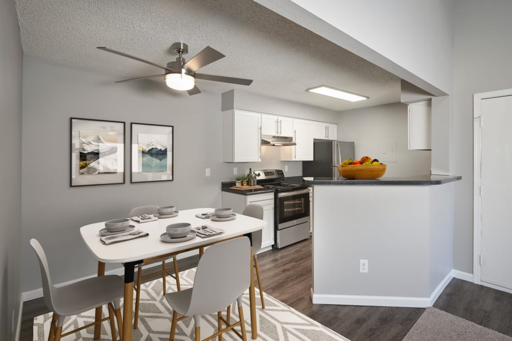 Kitchen with wood-style flooring at Alton Green Apartments in Denver, Colorado