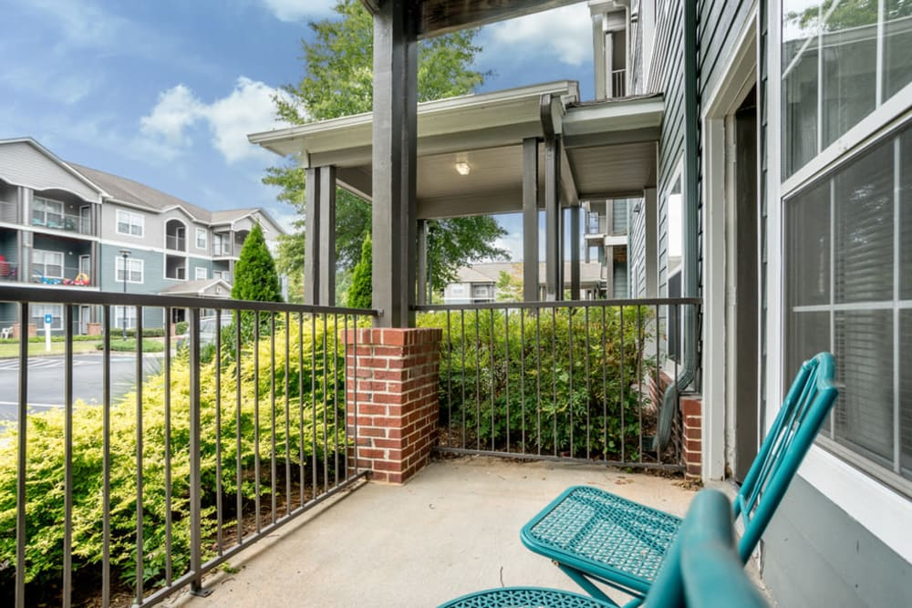 Seating on an apartment balcony at Peachtree Landing in Fairburn, Georgia