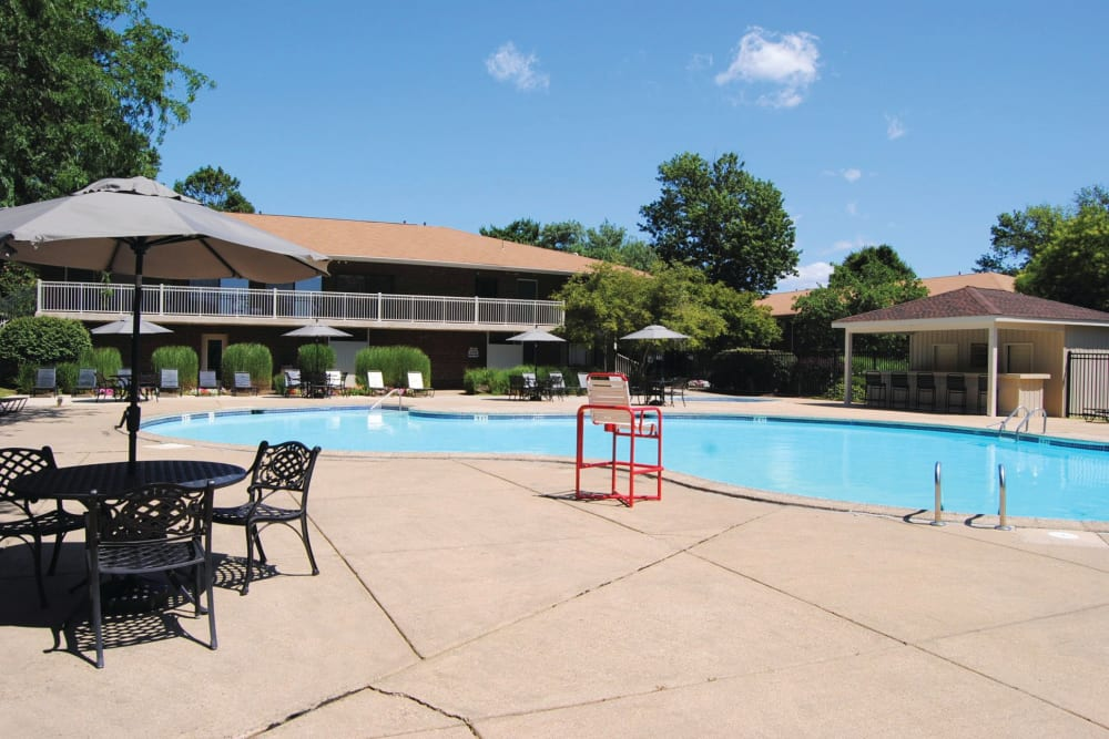 Poolside seating at Racquet Club Apartments and Townhomes in Levittown, Pennsylvania