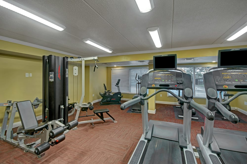Fully equipped fitness center at Racquet Club Apartments and Townhomes in Levittown, Pennsylvania