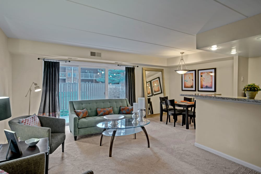 Spacious living room with patio access at Racquet Club Apartments and Townhomes in Levittown, Pennsylvania