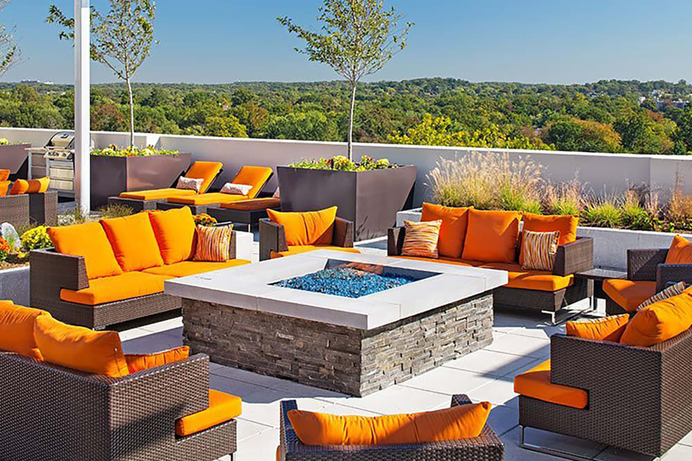 Poolside patio with firepit at Palette at Arts District in Hyattsville, Maryland
