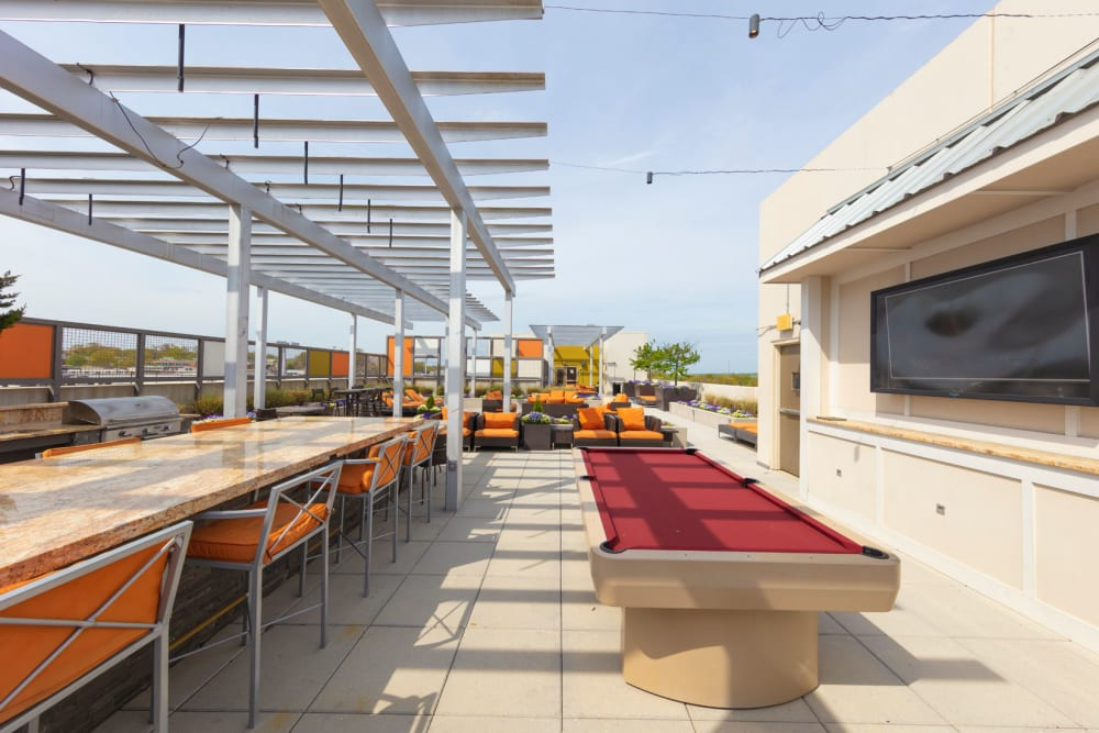 Outdoor pool table at Palette at Arts District in Hyattsville, Maryland