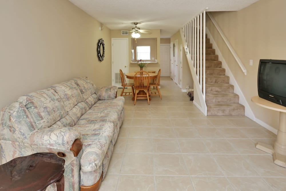 Well decorated living room at Stonewood Townhomes in Melbourne, Florida