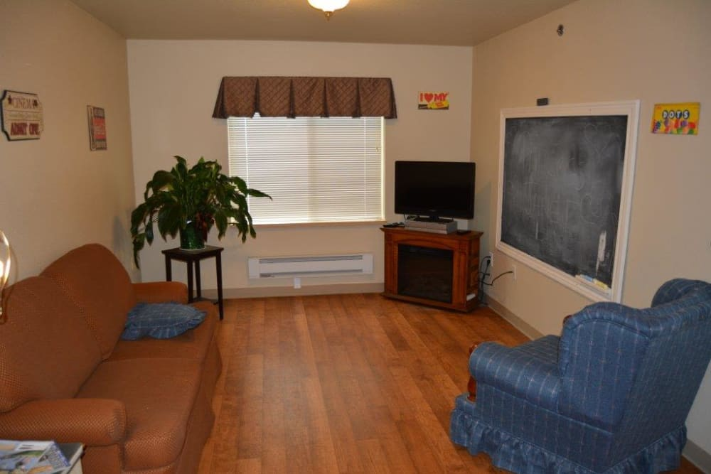 Comfortable living room in resident apartment at Courtyard Estates at Hawthorne Crossing in Bondurant, Iowa.