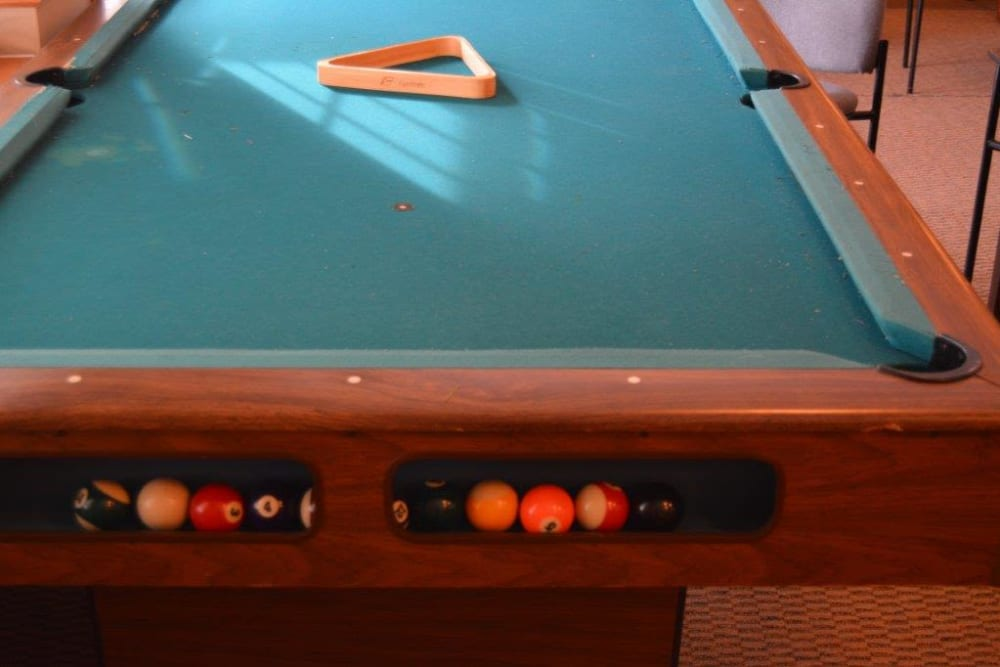 Resident game room includes a billiards table at Courtyard Estates at Hawthorne Crossing in Bondurant, Iowa.