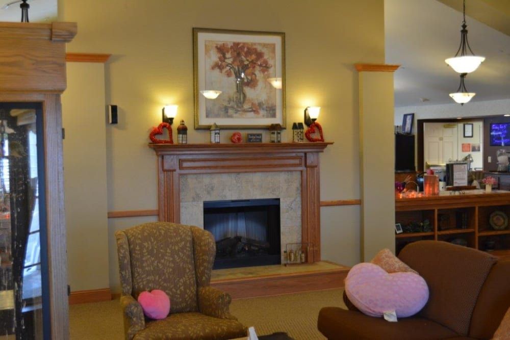 Bright seating nook near fireplace at Courtyard Estates at Hawthorne Crossing in Bondurant, Iowa.